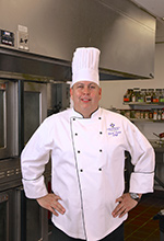 Jose Diaz in a chefs coat for the senior living facility in Olathe