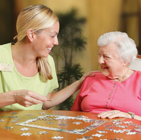 Scarborough Terrace senior living resident working on a puzzle.