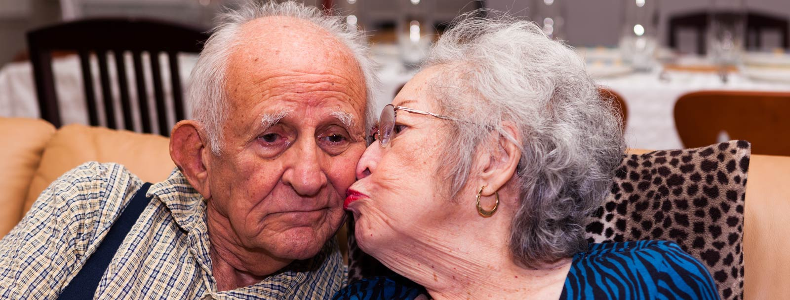 Happy couple kissing at the senior living community in Clay Center