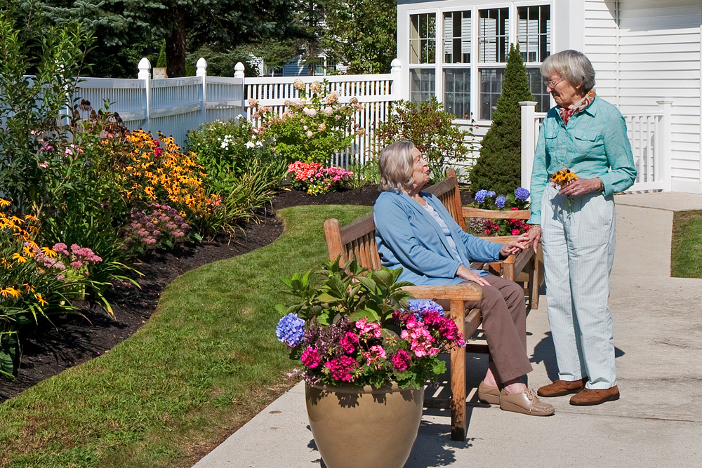 Friends gardening at senior living community
