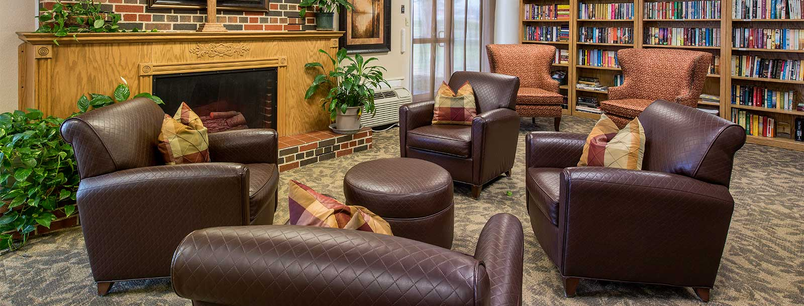 Residents enjoying the library at the senior living in Rolla