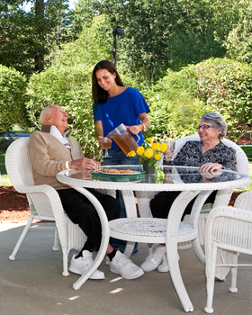 Tea time for seniors on the veranda at White River Junction, VT senior living.