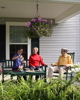 Tea time for seniors on the veranda at Woodstock, VT senior living.