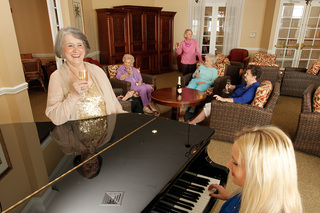 Large piano playing friends assisted living 14