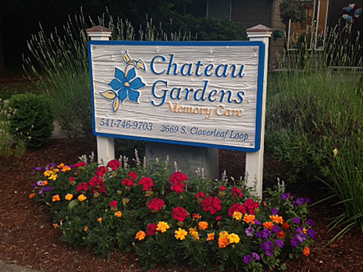 Chateau gardens sign and flowers