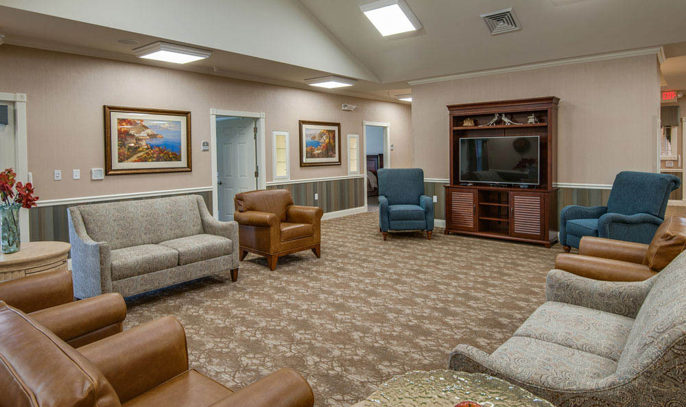 Videos and photos of the arbors at mill creek village in for Living room with lots of seating