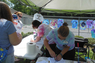Hard at work tye dying look all of thoes shirts