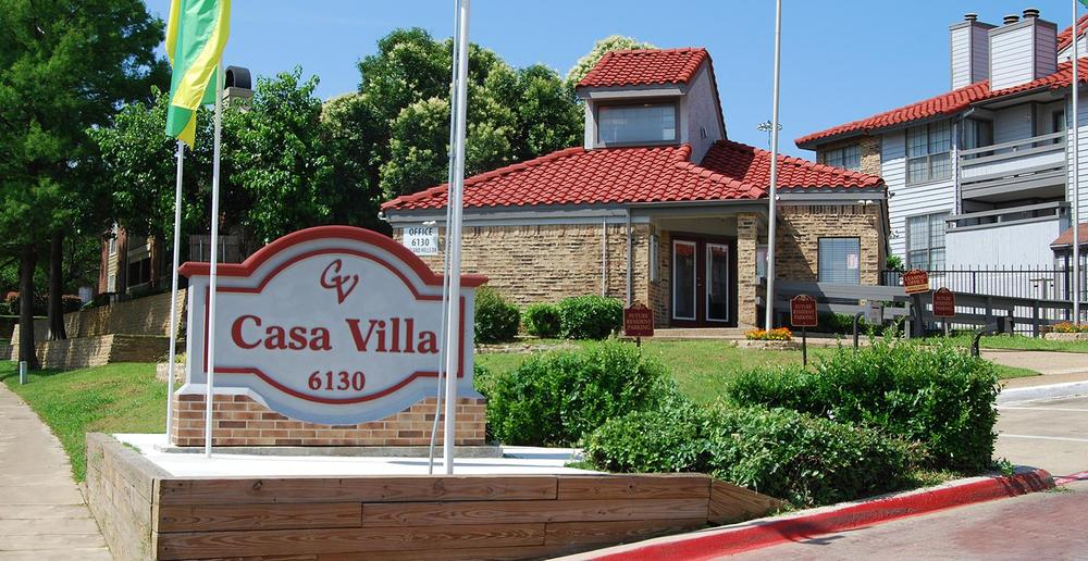 View of the entrance to Casa Villa Apartments in Fort Worth.
