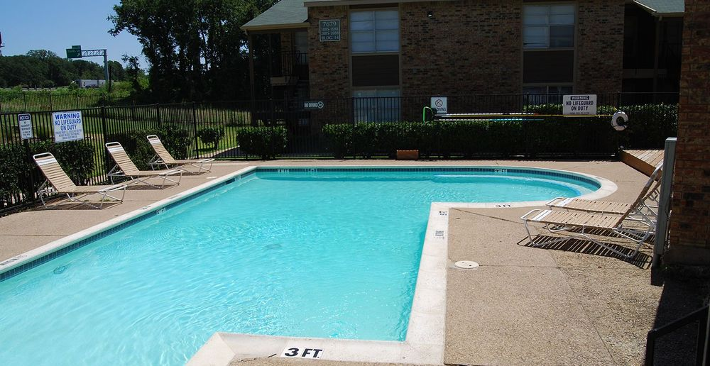 Take a dip in our sparkling pool at Tuscany Apartments.