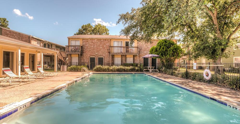 The pool is a great place to meet your new neighbors at Clear Lake Village Apartments.