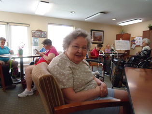 happy short term residents enjoy conversation at Mid-Valley Manor Personal Care Center