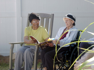 happy short term residents enjoy conversation at The Crossings at Steele Creek
