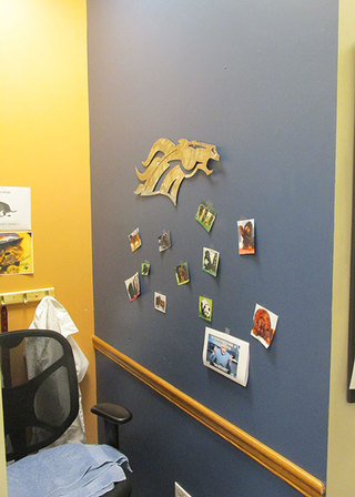 Office photo wall at care animal hospital