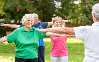 Senior living residents doing gymnastics and exercising