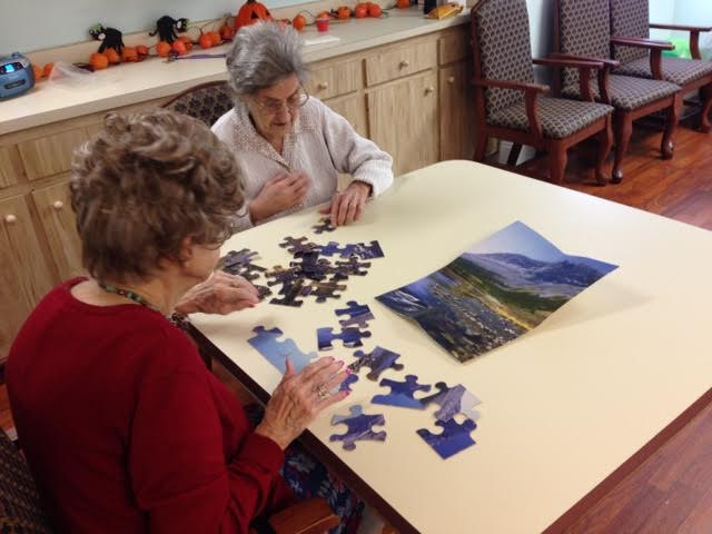 Seniors putting together a puzzle