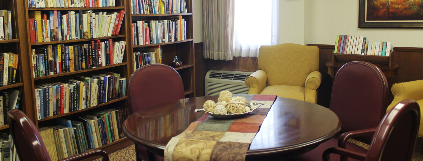 Residents enjoying the library at the senior living in Emporia