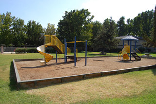 Emerald Pointe community amenities including a playground