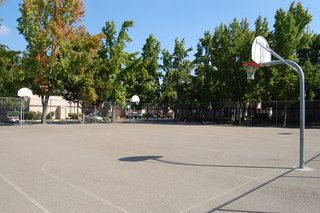 Our Modesto apartment amenities include a basketball court