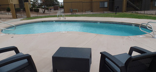 Pool lounge chairs at our apartments in sante fe nm
