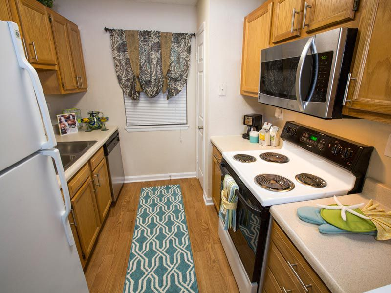 Galley kitchen at our apartments in bradenton