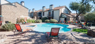 The patio near pool at apartments in midland tx