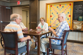 Playing cards at our senior living facility in loveland