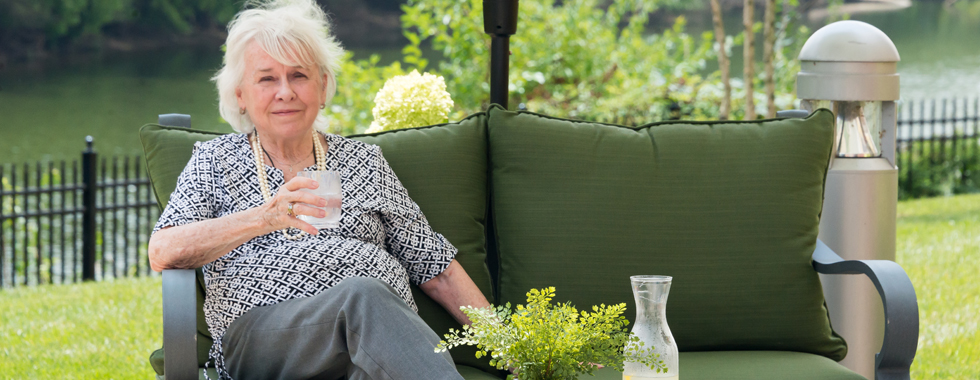 Home page woman enjoying drink in sun
