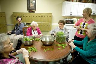 Pealing beans at our senior living home in la porte
