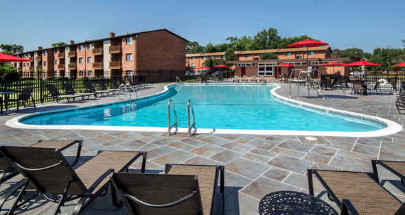 Amenities at Alexandria apartments include an outdoor swimming pool.