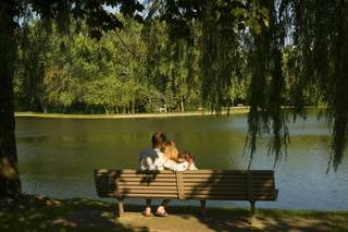 Couple on bench at lake house