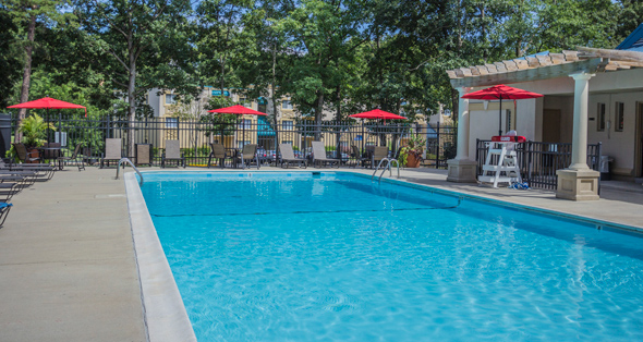 Residents enjoy an outdoor pool as one of the many amenities for apartments in Herndon
