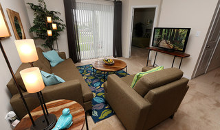 Pg spacious living room at apartments in mo