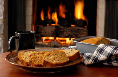 Cozy fireplace and warm baked bread at Broadmore Senior Living at Bristol in Bristol