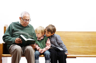 Dementia care grandfather reads to his grandchildren at Broadmore Senior Living at Teays Valley