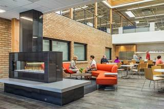 Touchmark central office atrium fireplace