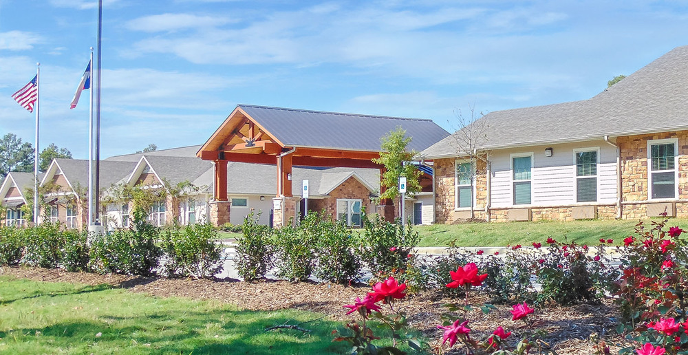 Huge assisted living in spring texas front entry landscape