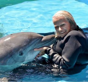 Resident Swimming with Dolphin