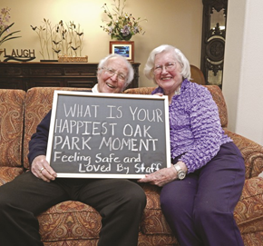 Residents holding a sign