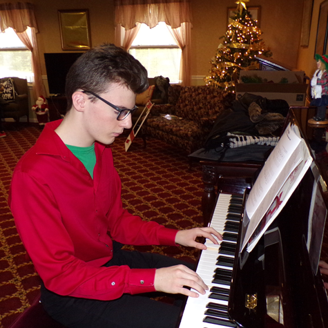 Junior leadership student playing the piano