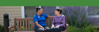 Touchmark edmond chatting outdoors with resident 7247