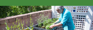 Touchmark sioux falls resident enjoying outdoor garden 0567