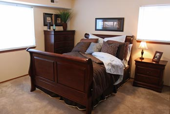 Resident concierge services available at Portage Pointe Apartment Homes apartments in Streetsboro include spacious bedrooms.