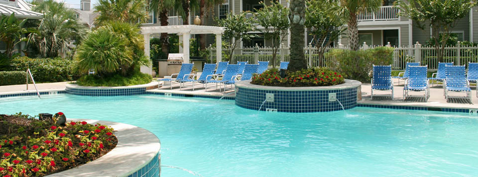 Pool lounge area at Moorings Apartments in League City, Texas