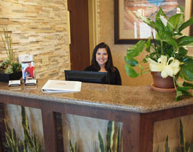 Desk clerk at Santé of Mesa enjoy a visit with their family.