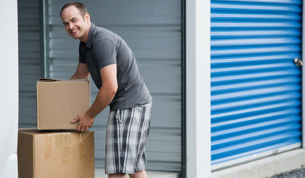 Man moving into storage Self Storage