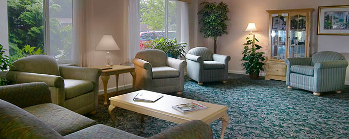 Sit comfortably in the lobby at senior living in Newport