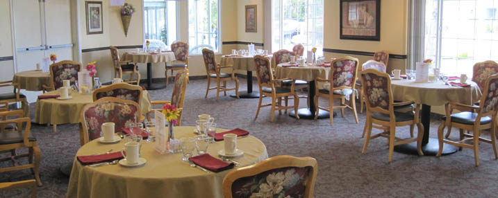 Large community dining room at senior living in Seaside