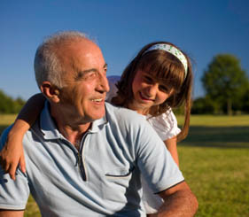 Senior man playing with his grandaughter happy that he compared the value of morningside house.