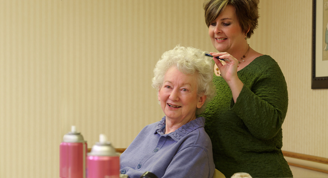 Residents take care of grooming needs in Garden View's Beauty/Barber Shop.
