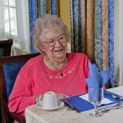 Senior resident dining at a Hearth Management LLC community